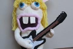 "N° 25 : Cale-porte ""Lapin crétin guitariste"""